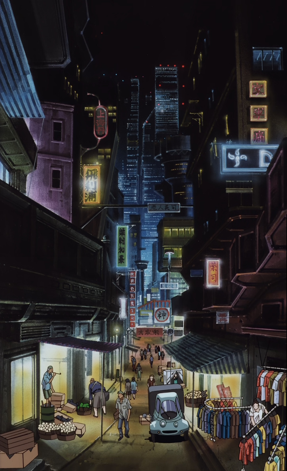 A long vertical shot of a market street in a city at night. People are walking down the road with vendors standing in the street. Skyscrapers are visible in the distance.